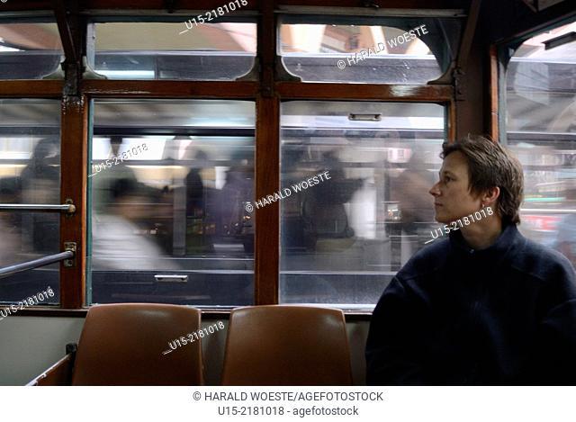 Hong Kong, China, Asia. European woman travelling in tram on Hong Kong Island