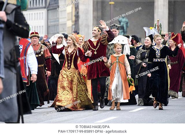 A group of people wearing Middle Age costumes walks the Ludwigstrasse (street) during the traditional costume parade in Munich, Germany, 17 September 2017