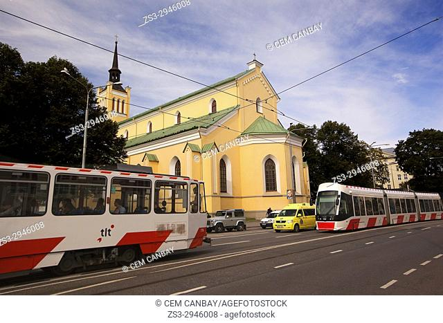 Trams in front of the St. John's Church in the old town, Tallinn, Estonia, Baltic States, Europe