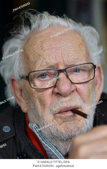 Crime writer Jacques Berndorf gestures during a press conference for his 80th birthday, at Cafe Sherlock in Hillesheim, Germany, 29 March 2016
