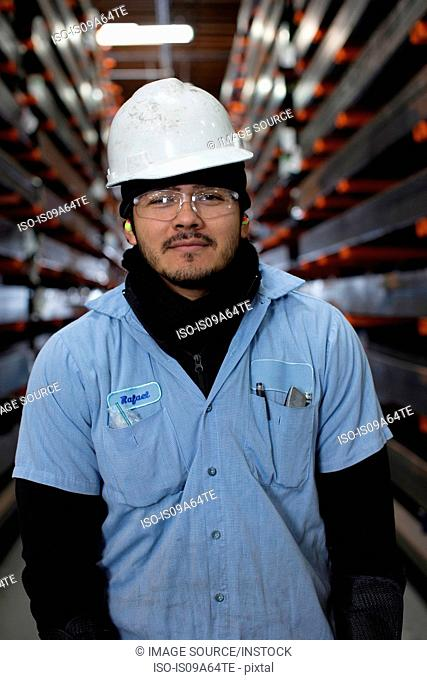 Worker standing in metal plant