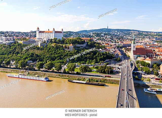 Slovakia, Bratislava, cityscape with river cruise ships on the Danube