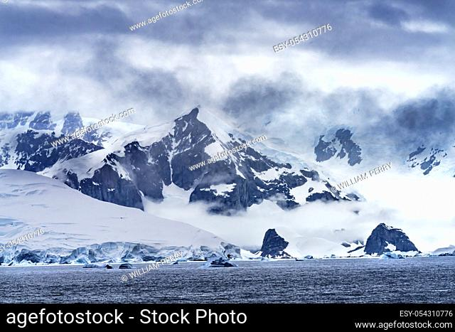 Snow Mountains Blue Glaciers Charlotte Bay Antarctic Peninsula Antarctica. Glacier ice blue because air squeezed out of snow