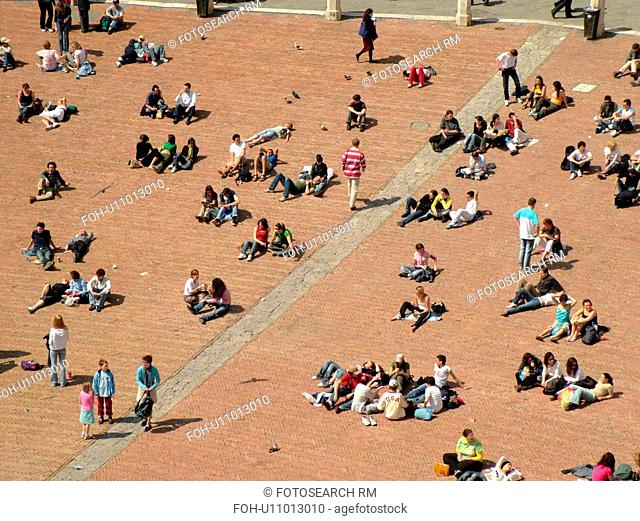 Tuscany, Italy, Siena, Toscana, Europe, Aerial view of people in the Piazza del Campo in the city of Siena from Torre del Mangia