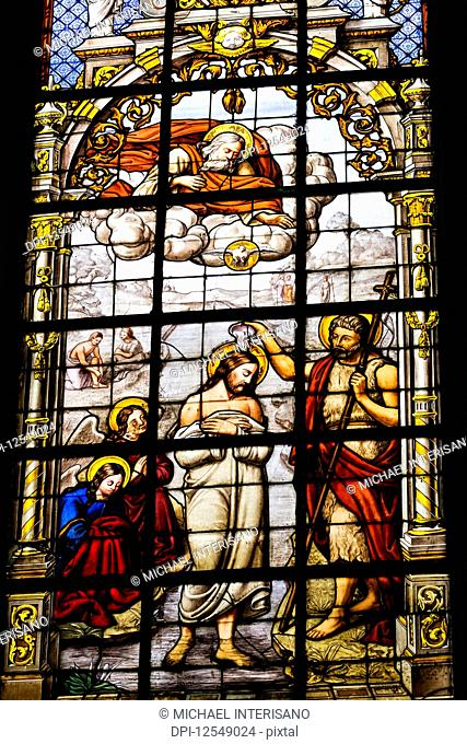 Stained glass church window of Christ's baptism; Brussels, Belgium