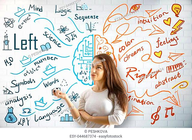 Left and right brain sides. Cheerful european woman on concrete wall with creative drawn pattern