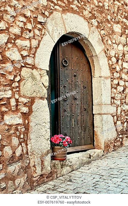 Flowers on a doorstep, Collbato, Spain