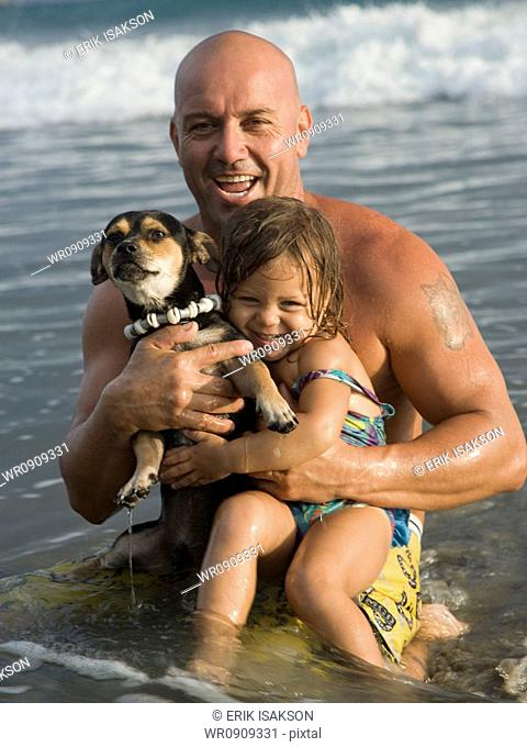 Father playing with young daughter at beach