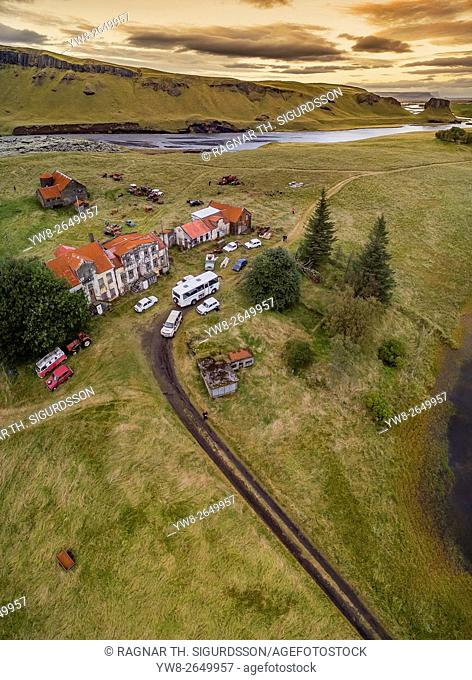 Old farm and cars decaying, Holmur Farm near Kirkjubaejarklaustur, Iceland. This image is shot using a drone