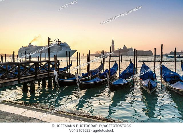 A luxury liner arriving in Venice in the early morning with San Giorgio Maggiore in the background, Italy, Europe