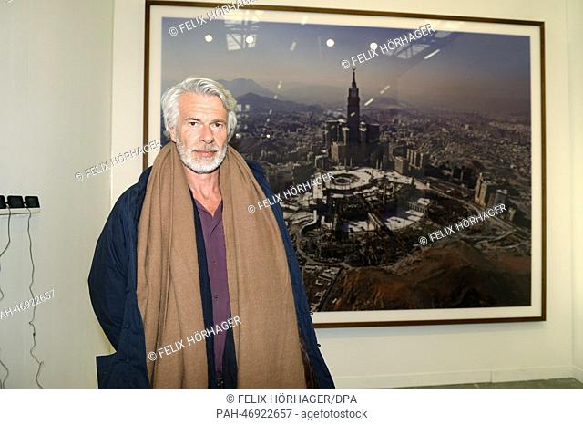 "Chris Dercon, Director der Tate Gallery of Modern Art poses in front of a work by artist Ahmed Mater depicting the city of Mecca during the art fair """"The..."