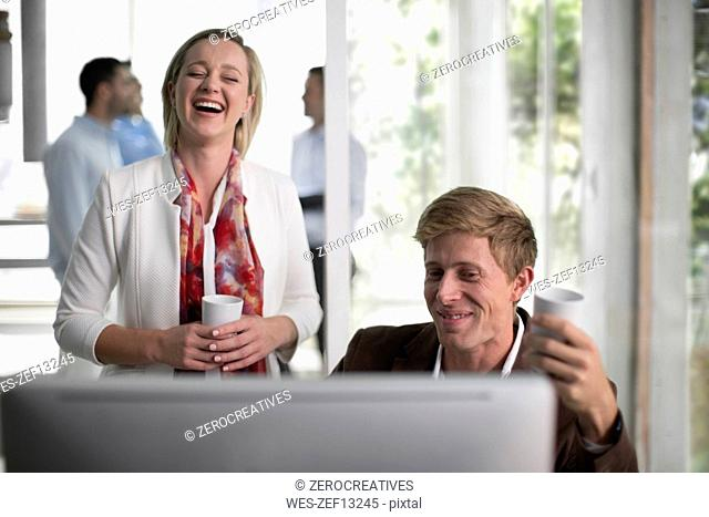 Colleagues talking in office