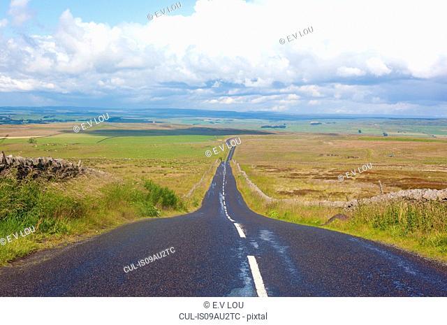 Diminishing perspective of rural road, Cumbria, UK