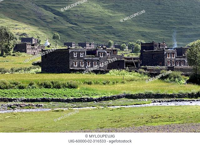 Traditional Tibetan style stone houses & river in the highlands of Kham - Sichuan Province, China, Tibet