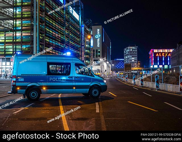 21 January 2020, Berlin: A police car is blocking Grunerstrasse. A German World War II bomb with a Russian detonator was found during construction work in front...