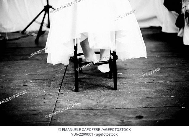 Barefoot bride on stool