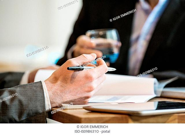 Businessmen working and making notes of discussion