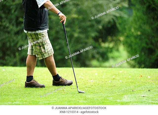 Golfer waiting their turn to play ball. Larrabea golf course, Alava, Basque Country, Spain