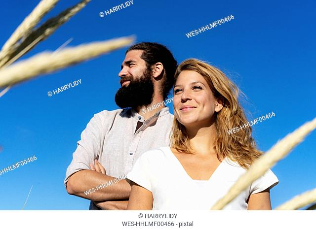 Confident couple spending time in nature