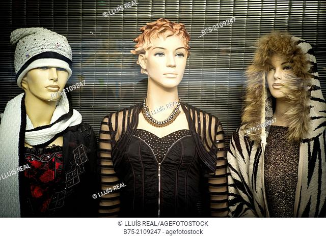 Three mannequins in the window of a fashion store in London, England, Uk, Europe