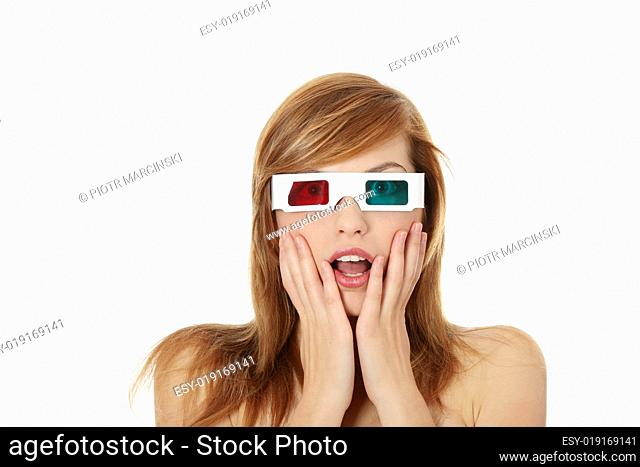 Beautiful young woman in 3d cinema glasses