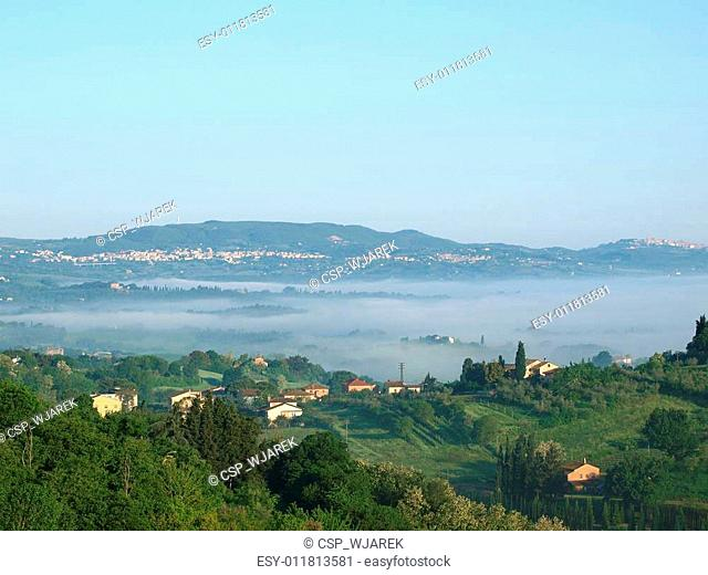 Fabulous landscape of the foggy morning in Tuscany. The valley between Montepulciano and Chiusi