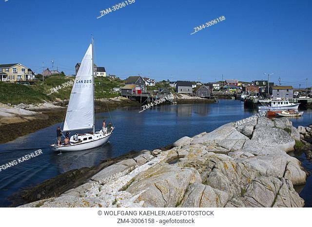 Sailboat entering the natural harbor of the fishing village of PeggyÂ's Cove near Halifax, Nova Scotia, Canada