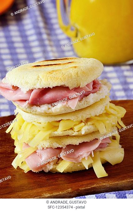 Arepas (round corn flatbreads with ham and cheese, Colombia)