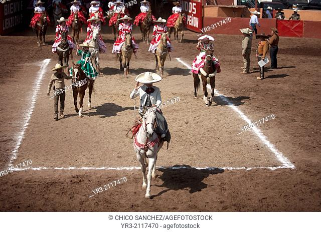"""Escaramuza teams enter the lienzo during an Escaramuza fair in the Lienzo Charros el Penon, Mexico City, Sunday, January 19, 2013"