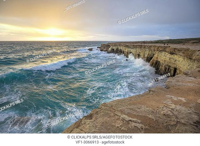 Cyprus, Ayia Napa, The sea caves at Cape Greco at sunset after a storm