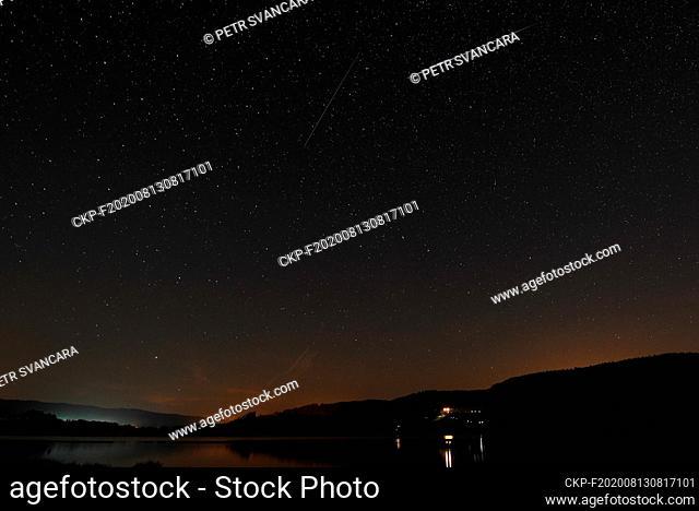 Perseid Meteor Shower in the night sky in the Letovice Dam near Blansko, Czech Republic, August 13, 2020. (CTK Photo/Petr Svancara)