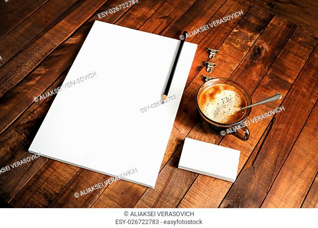 Photo of blank corporate identity template. Photo of blank ID. Blank letterhead, business cards, coffee cup and pencil. Mock-up for design presentations and...