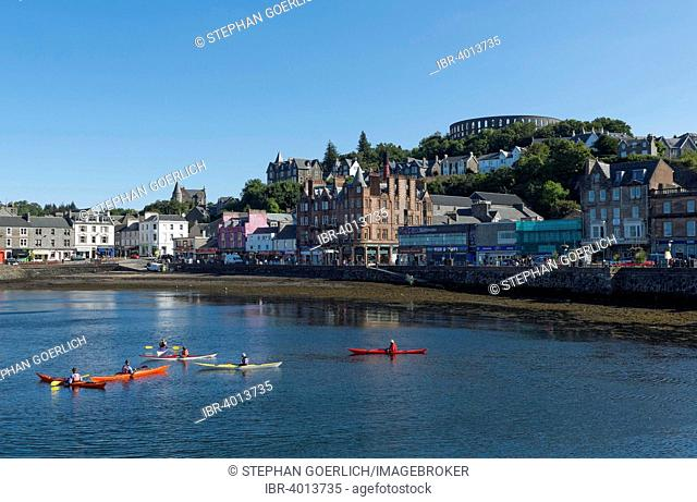 Port and McCaig's Tower on the hill, Oban, Scotland, United Kingdom