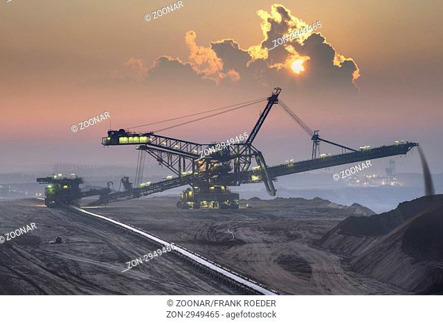 Spreaders in the early morning in open pit