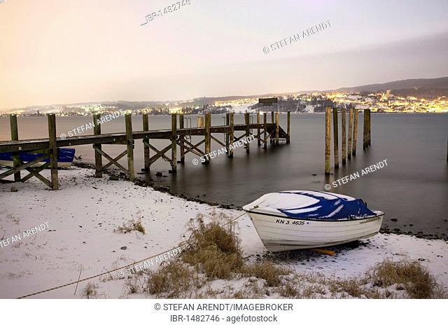 Pier at night on the island of Reichenau in winter, Baden-Wuerttemberg, Germany, Europe