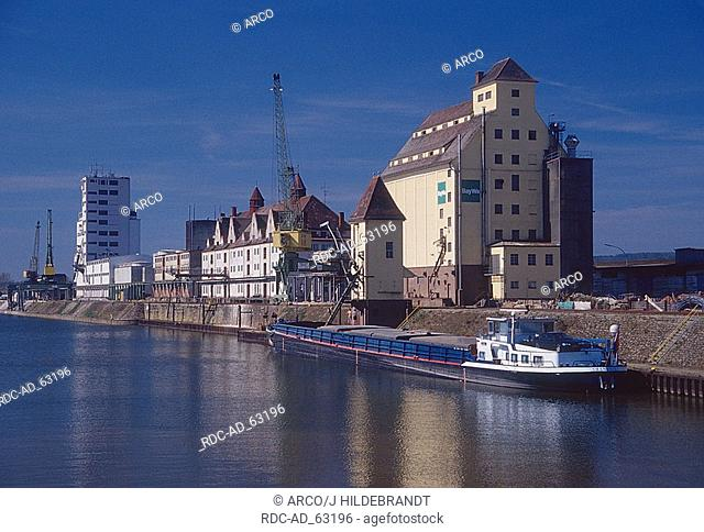 Ship in inland port in front of storehouse Bamberg Bavaria Germany