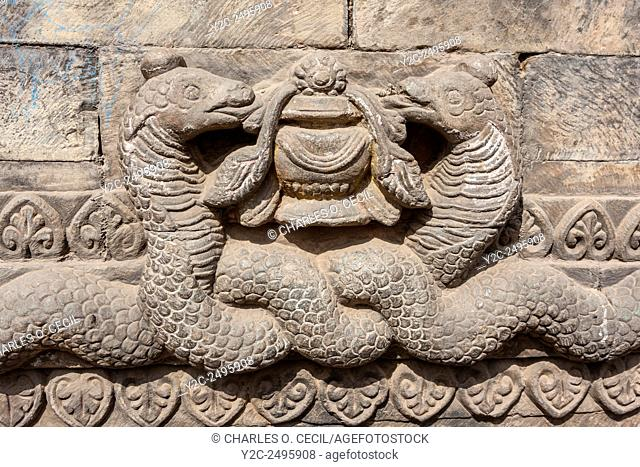 Bhaktapur, Nepal. Decorative Snake Detail on one of the Guardians Lining the Stairway to the Nyatapola Temple
