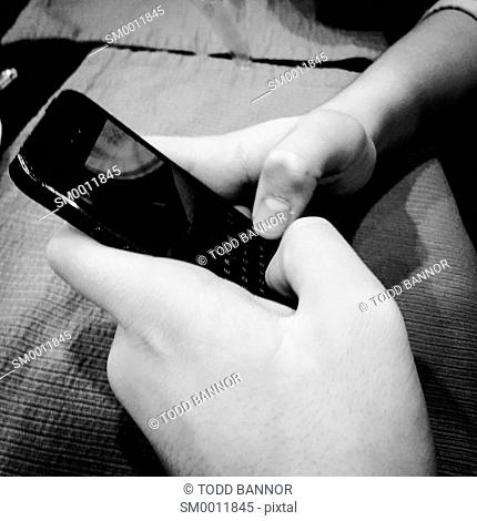 Young man's hands using smartphone