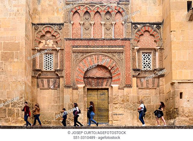 people front the Door and facade of San Ildefonso, Moorish facade of the Great Mosque in Cordoba, Andalusia, Spain