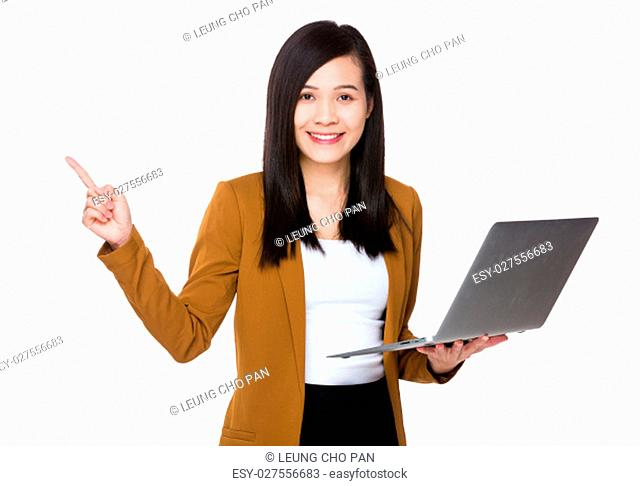 Young Businesswoman use of the notebook computer and finger point up