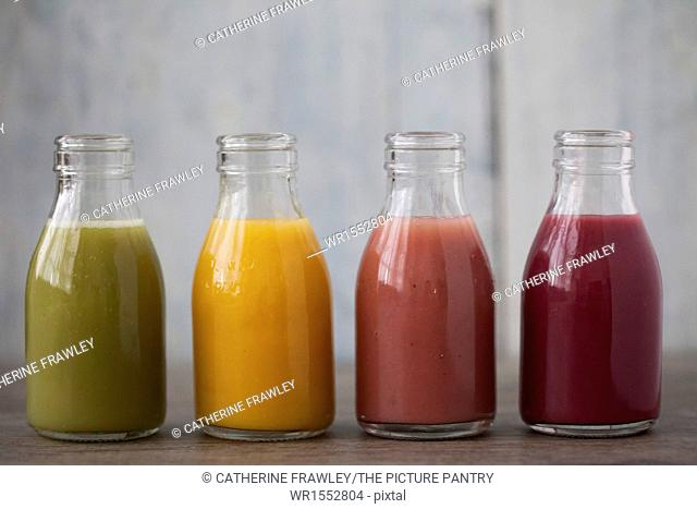 Four different smoothie flavours in mini milk bottles