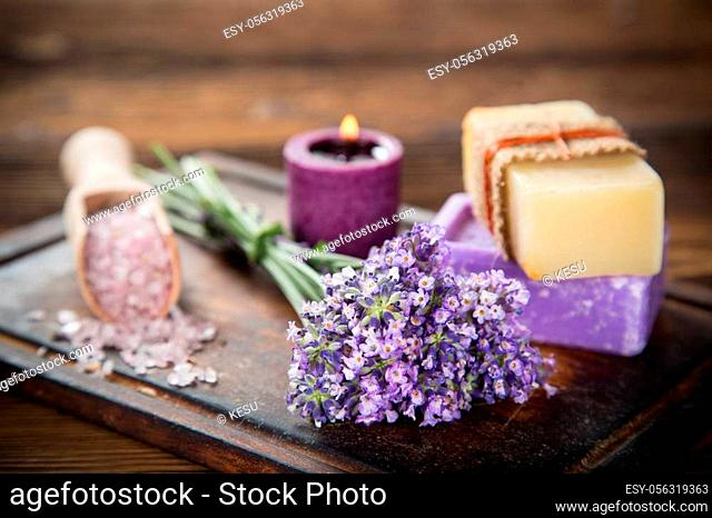 Wellness treatments with lavender flowers on wooden table. Spa still-life