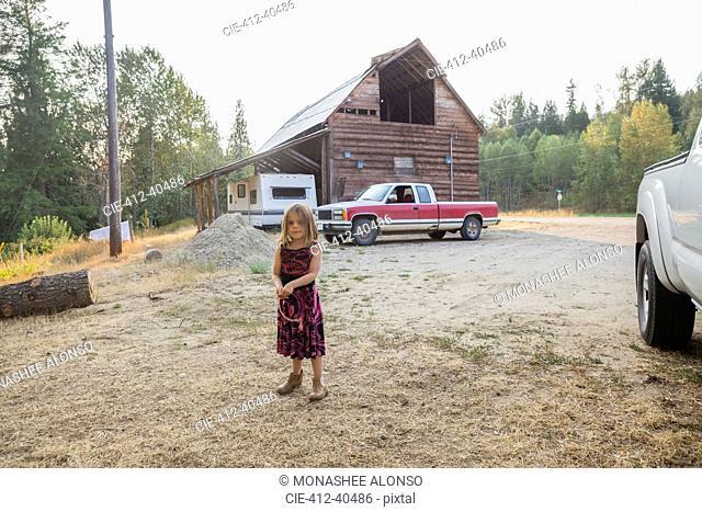 Portrait girl in dress on rural farm