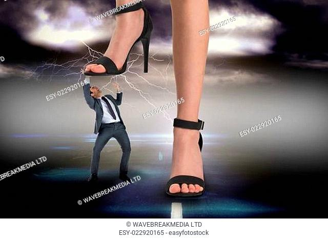 Composite image of female feet in black sandals stepping on businessman against stormy sky over road with lightning
