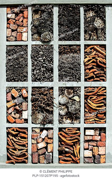 Insect hotel offering artificial nesting facilities for solitary bees and cavities for hibernating ladybirds and other insects