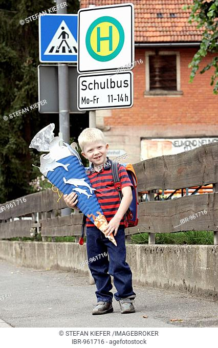 Schoolchild with a Schultuete, a large cornet of cardboard filled with sweets and presents, given to German children on their first day of school