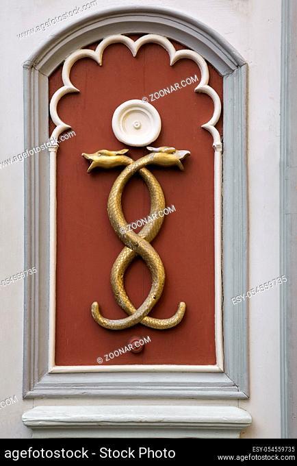 Wall decoration of two tangled snakes, Tallinn, Estonia