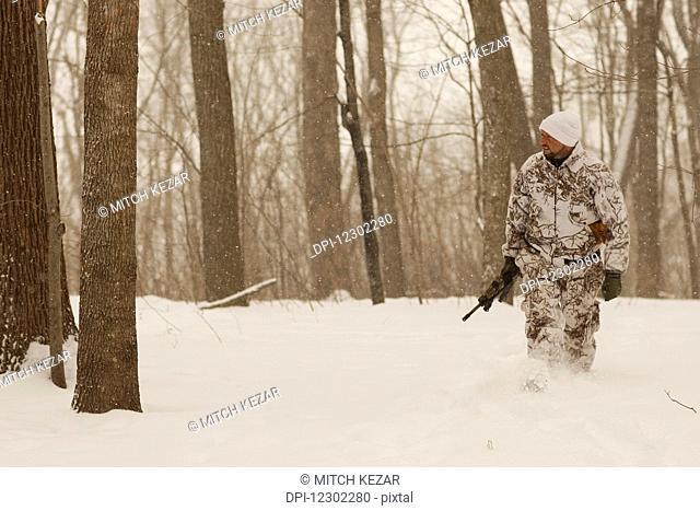 Small Game Hunter In Snow Camo In Winter