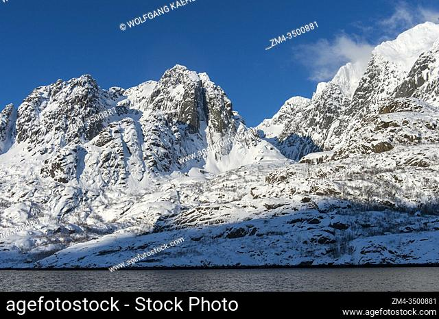 View of fjords with snow covered mountains near Svolvaer, a fishing town in the Lofoten Islands, Nordland County, Norway