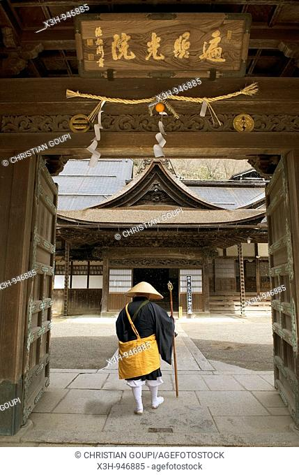 pilgrim at the gate of Temple,Koya-san, located in the mountain, this shintoist pilgrimage site is known for its landscapes and numerous temples Wakayama...
